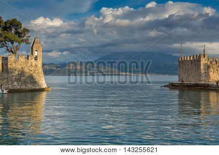 Sunset view of Fortification at the port of Nafpaktos town, Western Greece