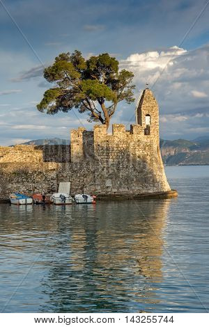 Sunset panorama of Fortification at the port of Nafpaktos town, Western Greece
