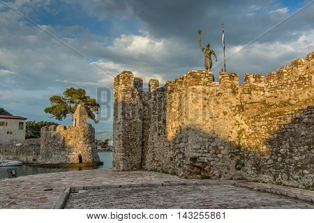 Sunset seascape of Fortification at the port of Nafpaktos town, Western Greece