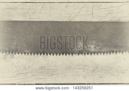 saw blade on a wooden background retro filter