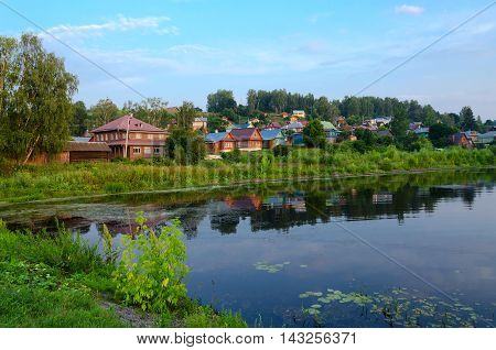 Quiet provincial town of Ples on shore of pond in summer twilight Russia