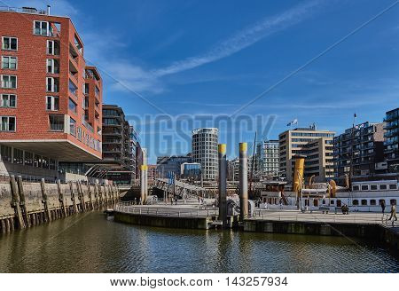 HAMBURG, GERMANY - MARCH 26, 2016: Modern buildings with offices and appartments embrace a little port with historic ships at new harbor city of Hamburg.