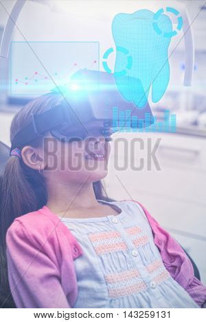 Digitally generated image of a teeth against girl using virtual reality headset during a dental visit