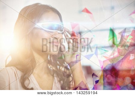 Colourful abstract design against businesswoman using virtual 3d glasses
