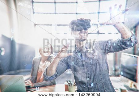 Virus background against male graphic designer using the virtual reality headset