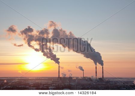 tubes with smoke at sunset in winter Russia