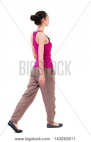 back view of walking  curly woman.  backside view of person.  Rear view people collection. Isolated over white background. dark girl walks slowly to the side.