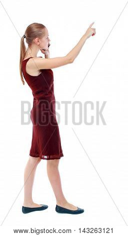 back view of pointing young beautiful  girl with tablet computer. girl  watching. Rear view people collection.  backside view of person.  Isolated over white background. The girl in the maroon