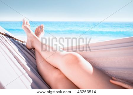 Woman relaxing in the hammock at the beach