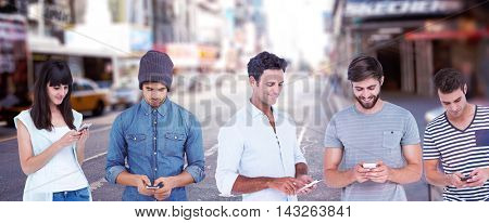 Handsome man text messaging through smart phone against blurry new york street
