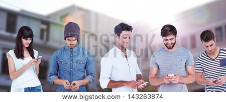 Handsome man text messaging through smart phone against low angle view of building