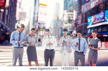 Business people using their phone against blurry new york street