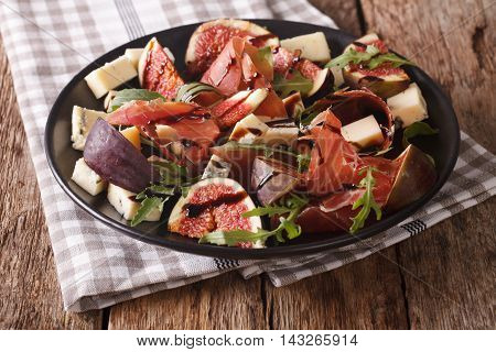 Salad With Figs, Blue Cheese, Arugula And Ham Dressed With Balsamic Sauce Close-up. Horizontal