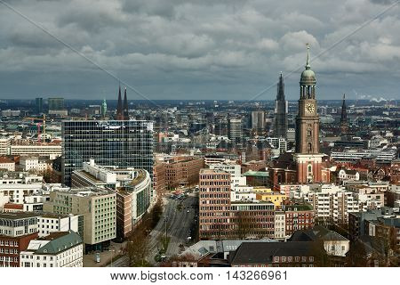 HAMBURG, GERMANY - MARCH 27, 2016: Scenic panorama over the city of Hamburg with the famous Michel.