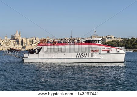 VALLETTA, MALTA. AUGUST 05, 2016: Sliema to Valletta ferry before Sliema dock.  The frequent ferry service from Valletta to Sliema covers the distance in about five minutes.