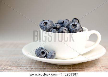 Lots of Berries blueberries in a tea Cup