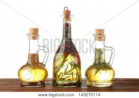 Olive oil with spices, isolated on white