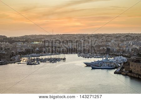 Malta panoramic skyline from Valletta at sunset
