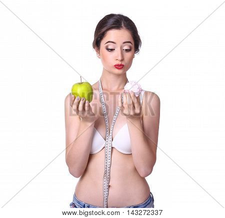 Young woman posing with fruits and measuring tape. Healthy lifestyle concept.