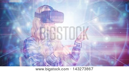 Pretty casual worker using oculus rift against black background with glowing network