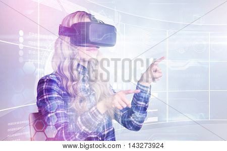 Pretty casual worker using oculus rift against futuristic technology interface