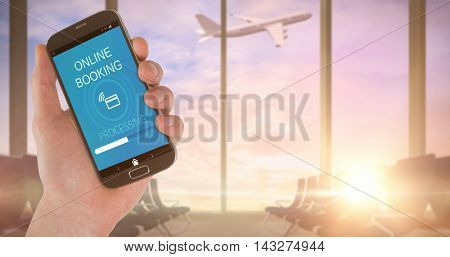 Hand showing a smartphone screen against airplane flying past departures lounge window