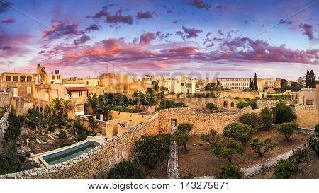 Malta - Amazing sunset and dramatic sky on a panoramic view at Mosta