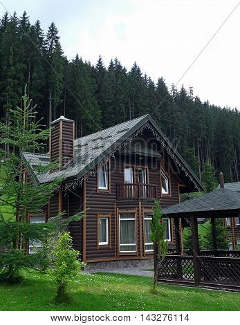 Country cottage with wooden arbor at the mountain health resort