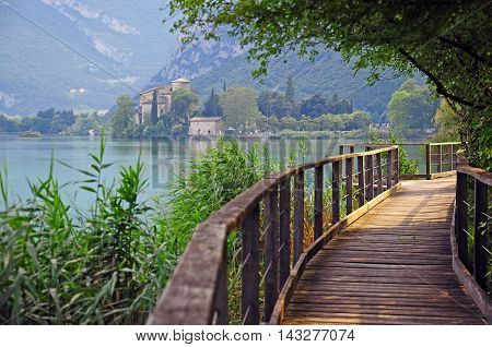 The stealing beauty: old castle and wooden path in Trentino Alto Adidge Italy