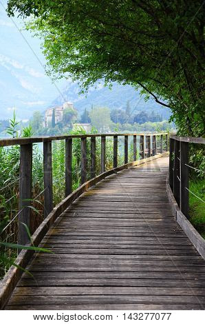 Wooden path to the castle. The stealing beauty northern Italy