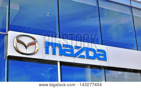 MOSCOW RUSSIA - OCTOBER 10 2015: Logo of Mazda corporation on October 10 2015. Mazda is a world-famous Japanese automotive manufacturer.