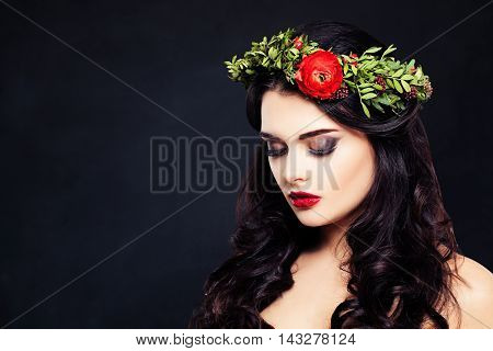 Healthy Woman with Flowers Wreath on Dark Background with Copyspace for Text