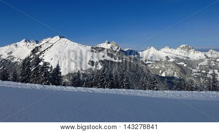 Snow covered mountains near Gstaad Switzerland. View from Mt Wispile.