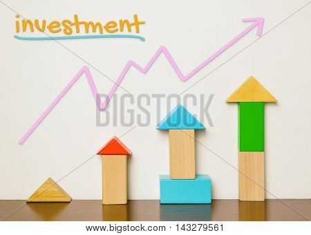 Childish Investment concept in colorful toy build up. Investment is fun and colorful. Block toys building up as financial investment graph diagram. Learning investment is easy for beginner.
