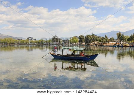 Heqing, China - March 16, 2016: Woman Taking Tourists On A Boat Ride In Heqing, Yunnan