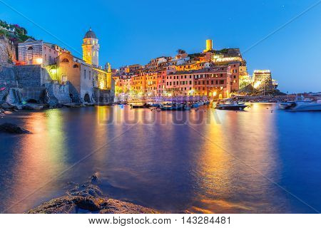 Night fishing village Vernazza with Santa Margherita di Antiochia Church and lookout tower of Doria Castle, Five lands, Cinque Terre National Park, Liguria, Italy.