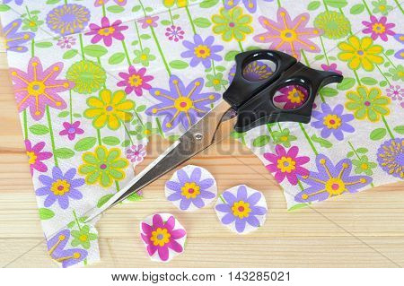 Napkin with flower pattern, scissors, cut pieces to decoupage. Step