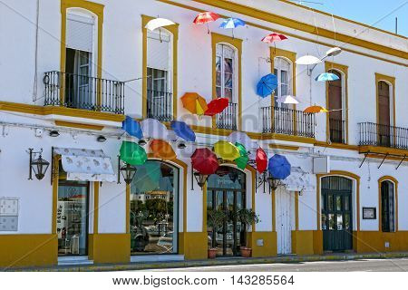 AYAMONTE / ANDALUCIA - AUGUST 14, 2015 - Umbrellas in typical street of ayamonte.