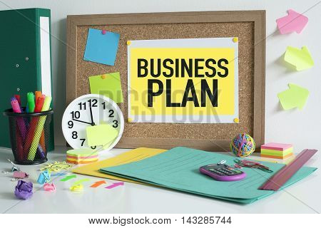 Business plan concept on bulletin board in office
