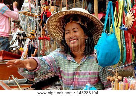 Damnoen Saduak Thailand - December 27 2005: Thai woman selling souvenirs at the Damnoen Saduak floating market
