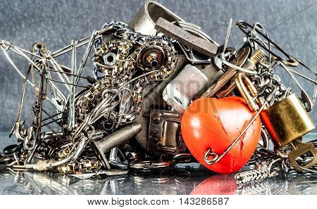 diverse iron pieces adhere to the magnet and red heart