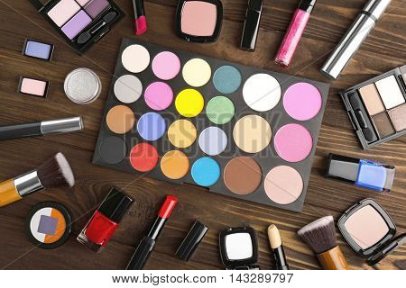 Colorful eye shadow palette and accessories, closeup