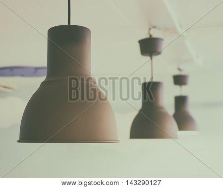 Cafe Round Ceiling light in Vintage tone. Three Brown Metal Ceiling light restaurant lamp arrangement.