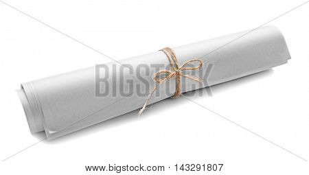 Rolled paper tied with cord isolated on white