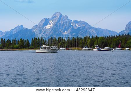 lakeside and the mountains with the boats