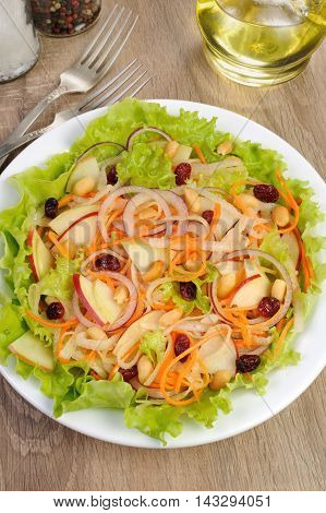 Dietary salad with apples daikon carrots lettuce cranberries and peanuts