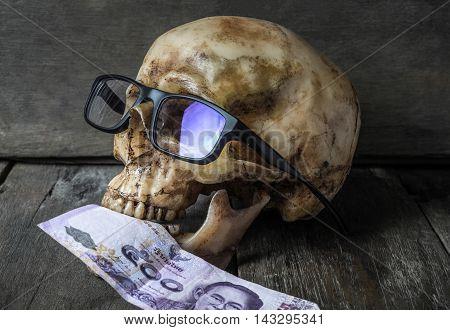 Business man Human Skull bone eating Money