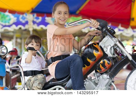Happy Children Having Fun Riding