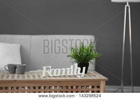 Word Family on wooden table in room