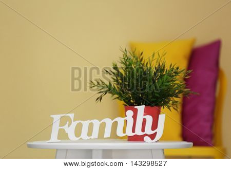 Word Family and plant on white table